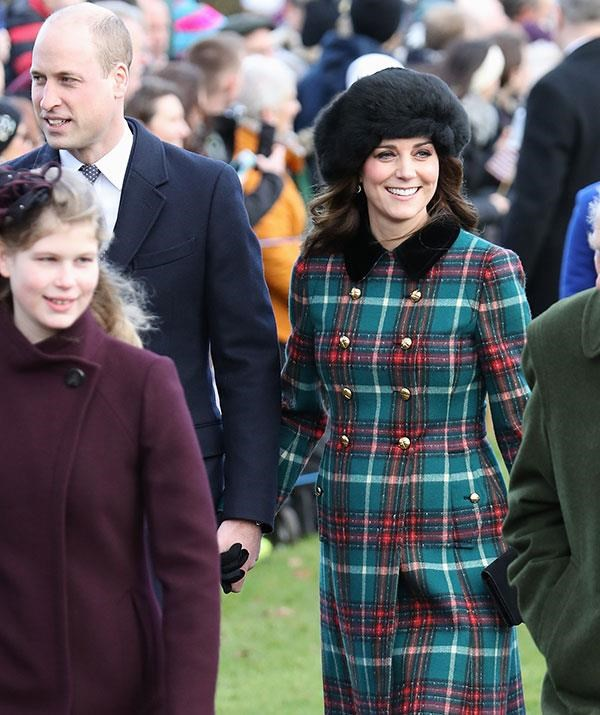 Kate beamed as she walked toward the service with hubby William.