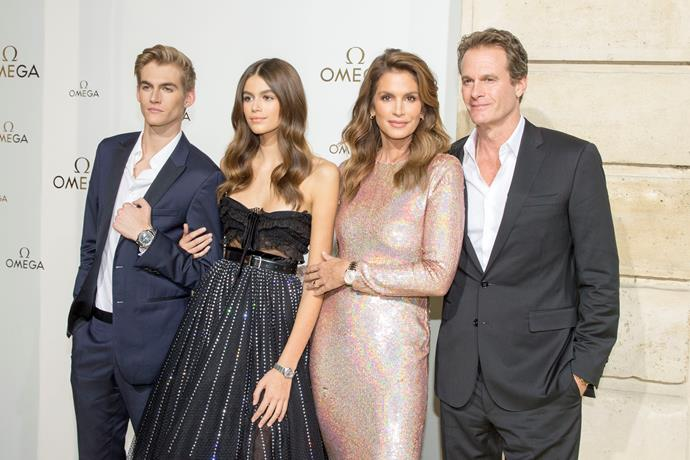 **Presley and Kaia Gerber** with parents Cindy Crawford and Rande Gerber.