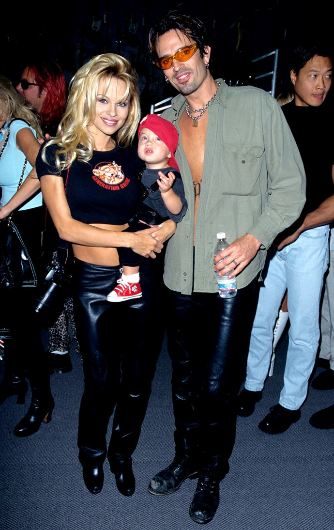 **Brandon Lee** as a baby, with parents Pamela Anderson and Tommy Lee.