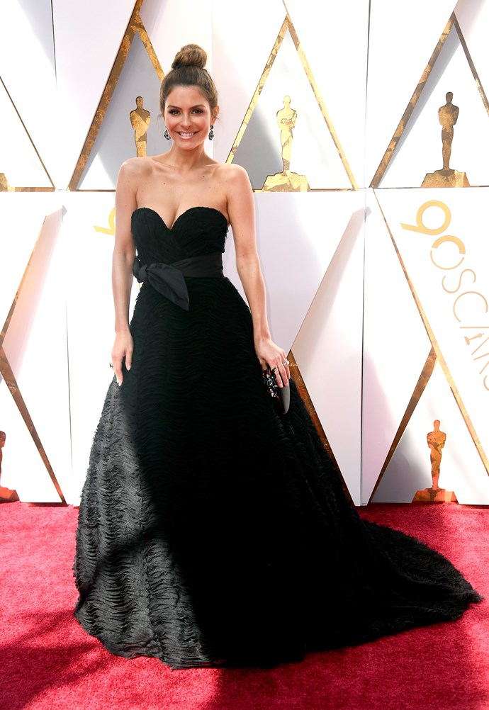 Maria Menounos keeps it classic in a dramatic black ball gown.