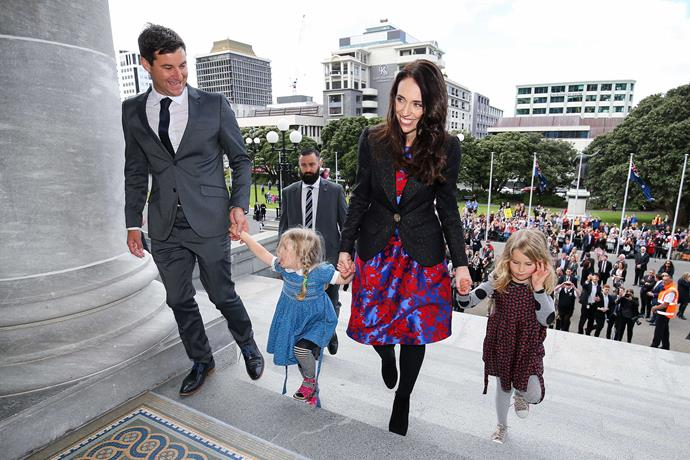 The couple with Clarke's nieces Rosie and Nina on their way into Jacinda's swearing-in ceremony.