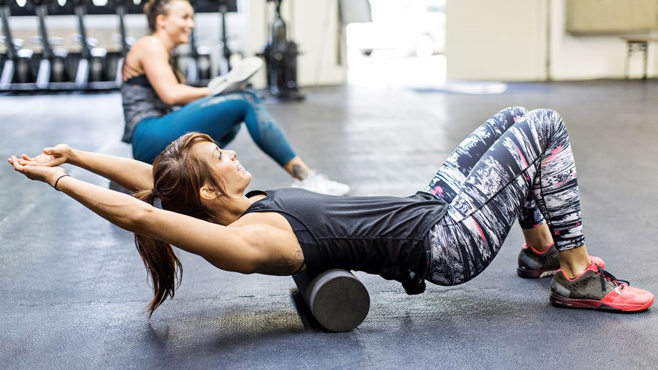 Foam rolling before you work out can help you get the most out of your workout, by making movement easier and helping to build muscle more effectively. *(Image: Getty)*