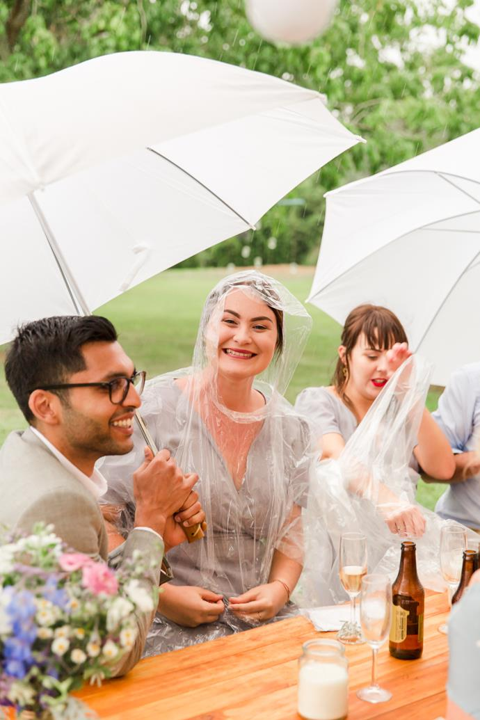 The couple's goodnatured guests happily accessorised with plastic ponchos and umbrellas.