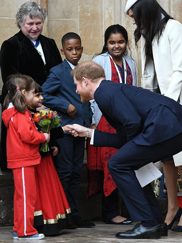 Harry seemed besotted by the pint-sized guests.
