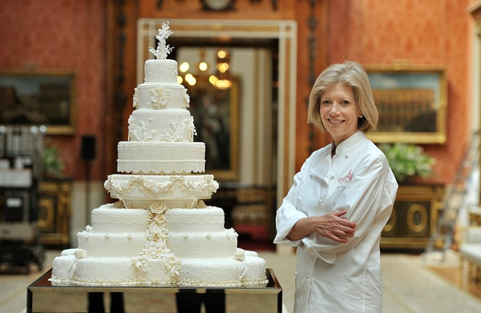 Fiona Cairns stands next to the grand eight-tier cake she created for William and Kate's 2011 wedding.