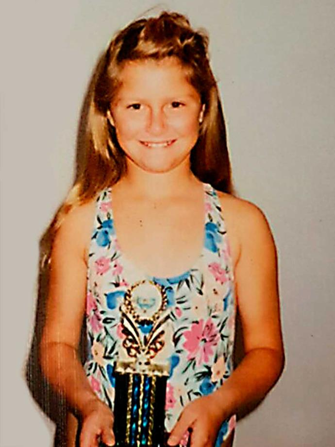 Toni, aged 10 with a swimming trophy.