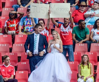 Newlyweds leave wedding celebrations to get to rugby game
