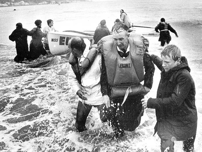 A Wahine passenger being helped to shore.