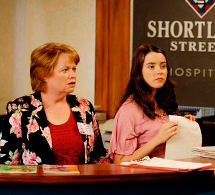 Emily as Shorty receptionist Claire, alongside co-star Alison Quigan as Yvonne Jeffries.