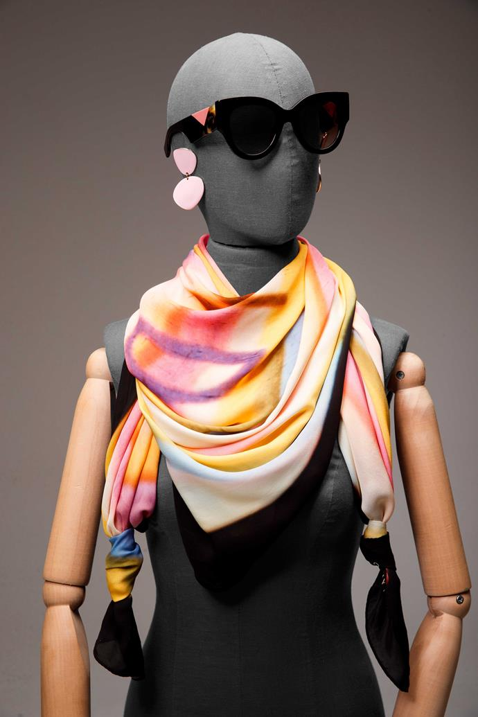 "**2 The artist.** While what's printed on a scarf is pretty in itself, the true beauty of the garment is when you artistically wrap it so [the colours](http://www.nowtolove.co.nz/fashion/fashion-trends/how-to-wear-less-black-and-embrace-colour-33845|target=""_blank"") create a new design of their own, with the original image kept a stylish secret for the wearer. In this instance, a watercolour Deadly Ponies scarf has been loosely draped around the neck with two ends tied in simple knots to give the pastel pattern a little edge.                                                                                                     *Fendi sunglasses, $645, from Sunglass Bar. Earrings, $39, by Ruby. Scarf, $230, by Deadly Ponies.*"