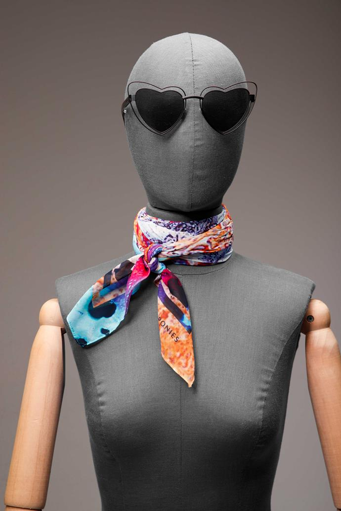 **3 The lover.** Skinny neckties need only to be tied simply to make the most impact – just add novelty, heart-shaped sunnies to position yourself as more hot date, less air hostess.                                                                                                                                                                                                            *St Laurent sunglasses, $695, from Parker & Co. Scarf, $230, by Deadly Ponies.*