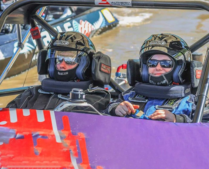 Pip (right), behind the wheel of a jet boat.
