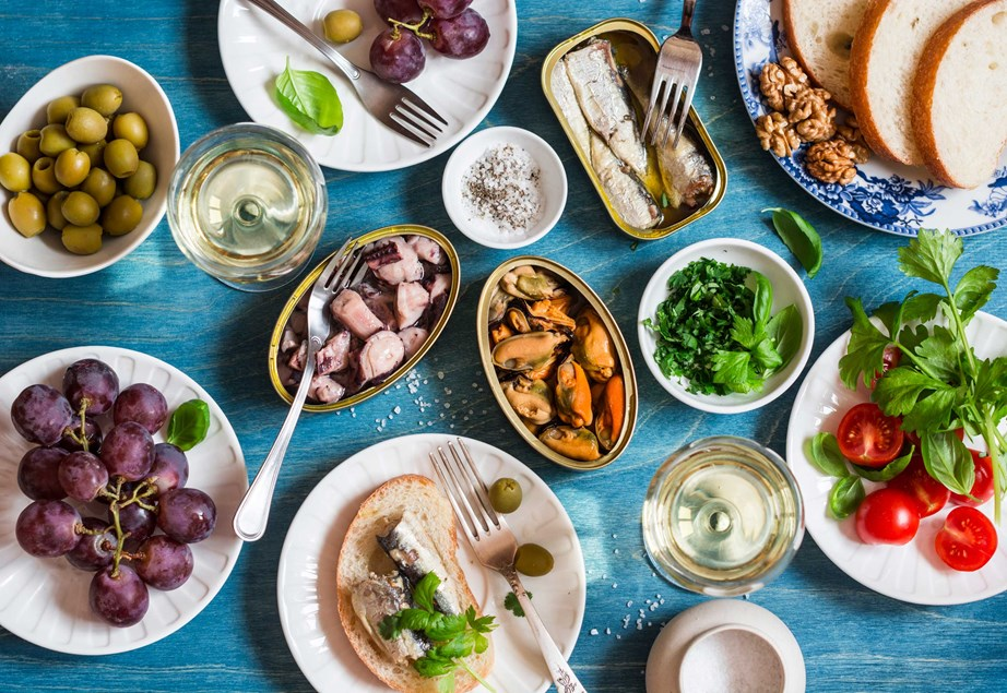 The Mediterranean diet focuses on plant-based foods like fruit and vege, legumes, seafood and healthy fats. *(Image: Getty)*