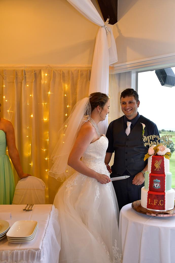 The couple's wedding cake featured the crest of the groom's favourite football team, Liverpool FC.