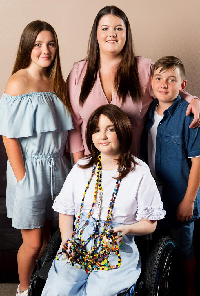 Aneliese showing her courage beads, with siblings (above, from left) Alyssa, Louise and Logan.