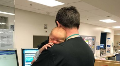 The emergency department surgeon who doubles as a baby whisperer