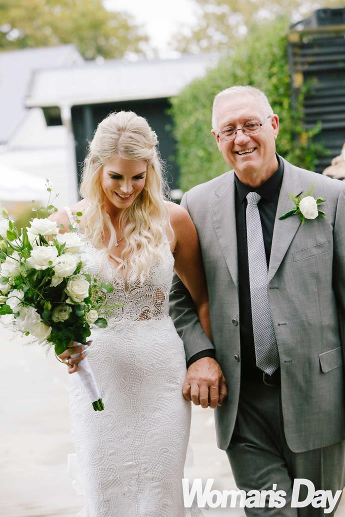The bride arrives on the arm of her proud dad Ron Sadler.