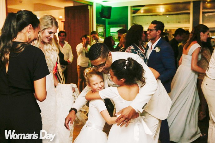 Dad – and now stepdad – Pua dishes out the hugs.