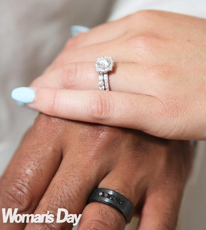 Pua's ring is black titanium with five black diamonds. Lizz's is a platinum band to go with her engagement ring.
