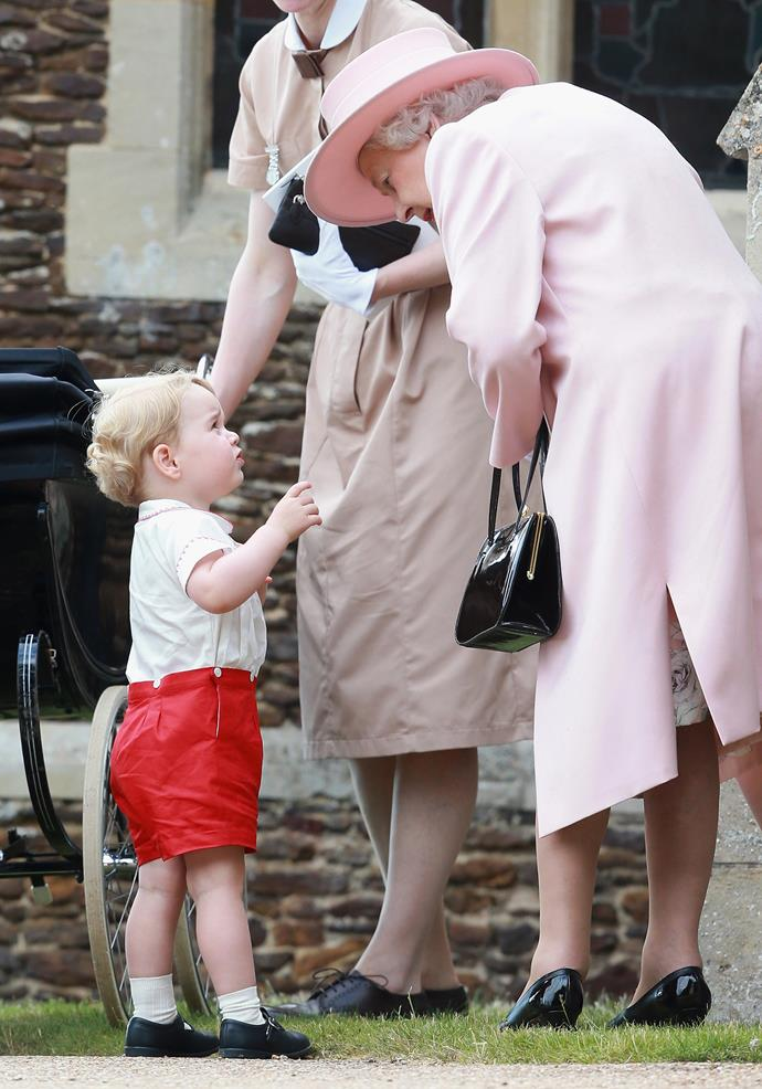 The Queen, pictured here with Prince George at Princess Charlotte's christening, always leaves treats out for her great-grandchildren on their beds when they come to say, reports Duchess Catherine.