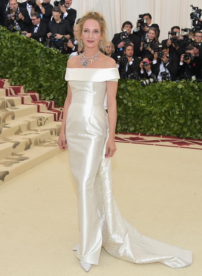 Uma Thurman's jewels sparkled against her white gown.