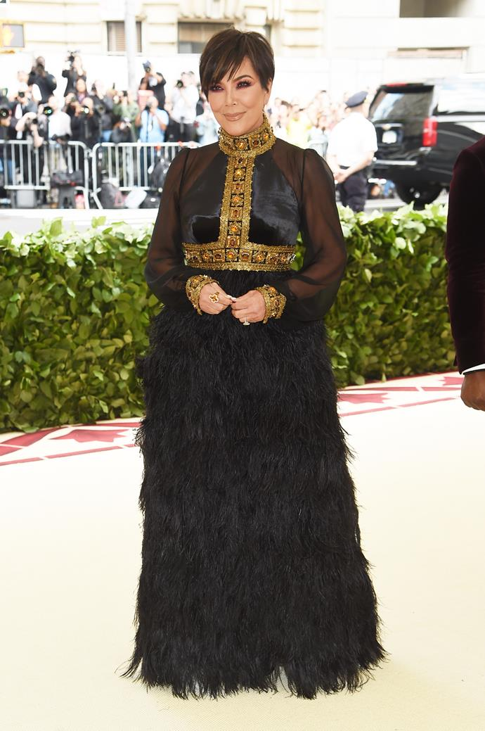 *Keeping Up With The Kardashian's* matriarch, Kris Jenner, opted for a full-skirt of black feathers.