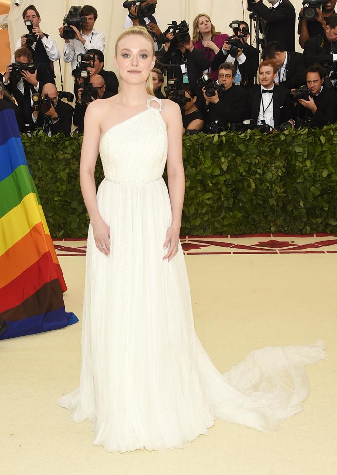 Dakota Fanning looking elegant in a one shoulder gown.