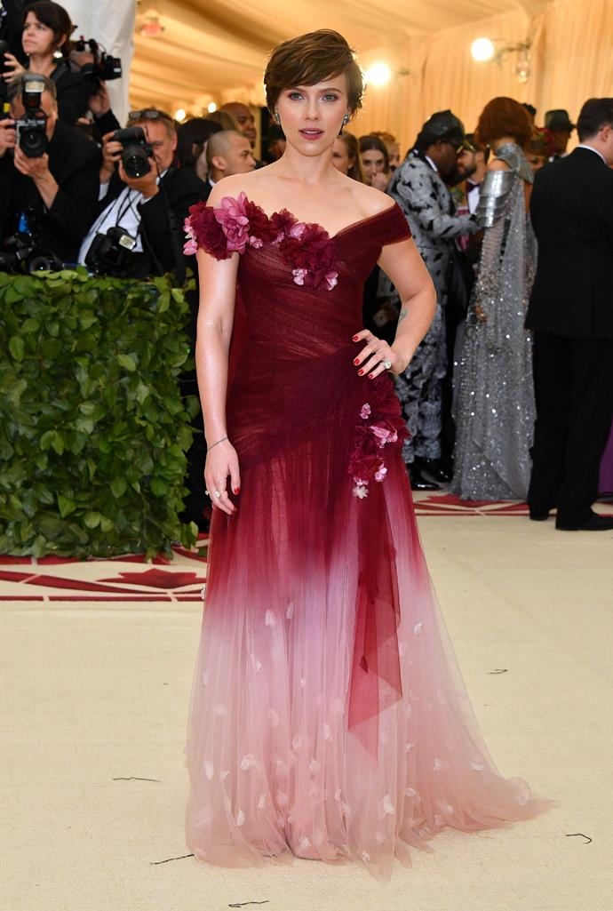 Pretty in pink and maroon! Scarlett Johansson looks stunning in her flower Marchesa gown.