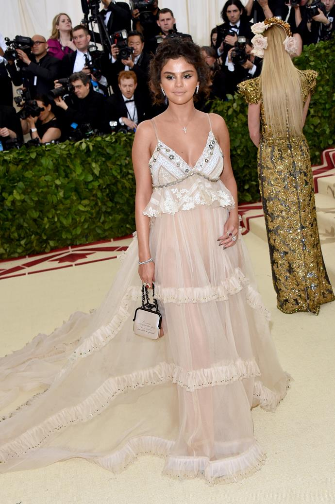 Selena Gomez looks gorgeous in her sheer embellished gown.