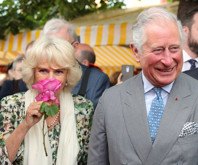 Prince Charles and Camilla, Duchess of Cornwall, stop to smell the flowers.