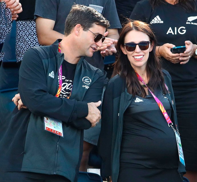 Clarke and Jacinda  watching the triumphant New Zealand women's Black Sticks win gold at the Gold Coast Commonwealth Games.