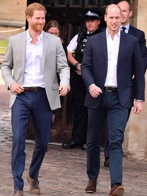 Prince Harry and Prince William greet the crowds on the eve of the Royal Wedding.