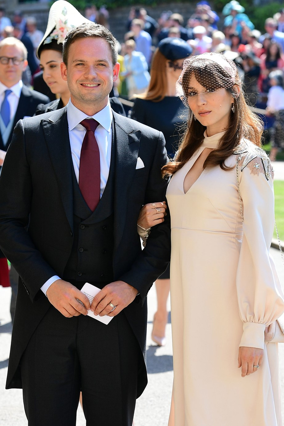 Patrick J Adams and his wife and actress Troian Bellisario at Prince Harry and Meghan's wedding last year. *(Image: Getty)*