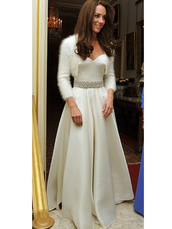 Kate's second dress, a demure satin gown, was designed by Sarah Burton for Alexander McQueen, the same designer as her first wedding dress.