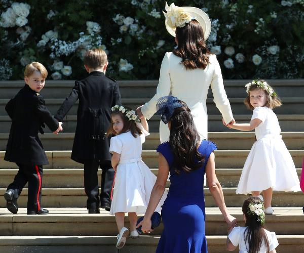 With a little help from Duchess Kate, the bridal party make their way into the chapel.
