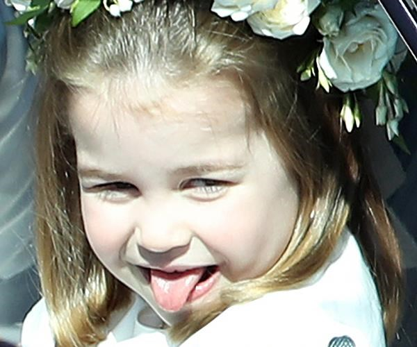 It looks like she's just as cheeky as her older brother George, Princess Charlotte pokes her tongue out at the crowd as she heads to Prince Harry and Meghan's wedding where she was a flowergirl.