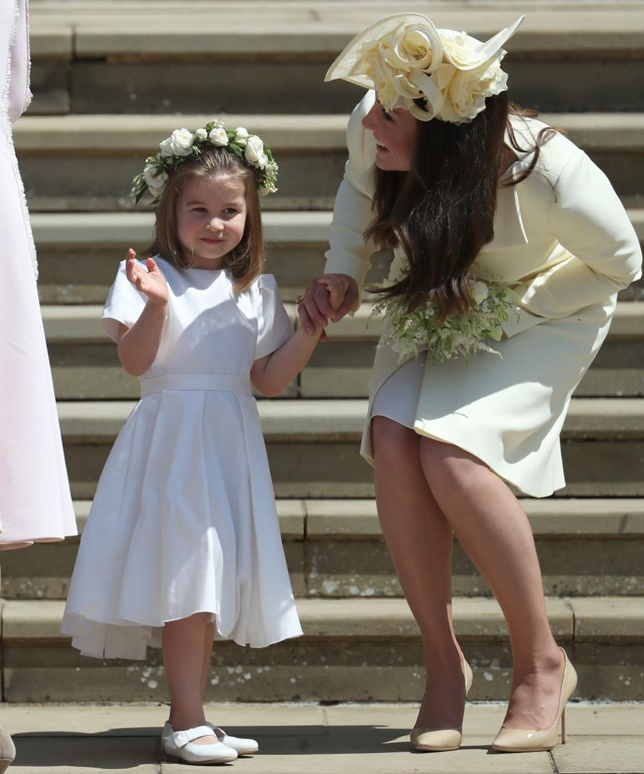 But once with her mum, the princess was back to royal waves, and looking adorable doing so. *(Image: Getty)*