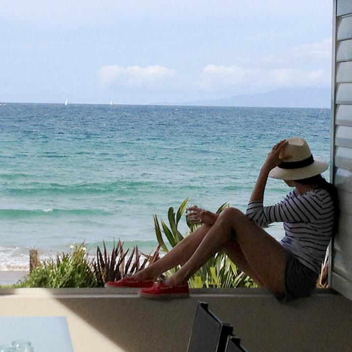 Meghan enjoys the view from her bach on Waiheke Island.