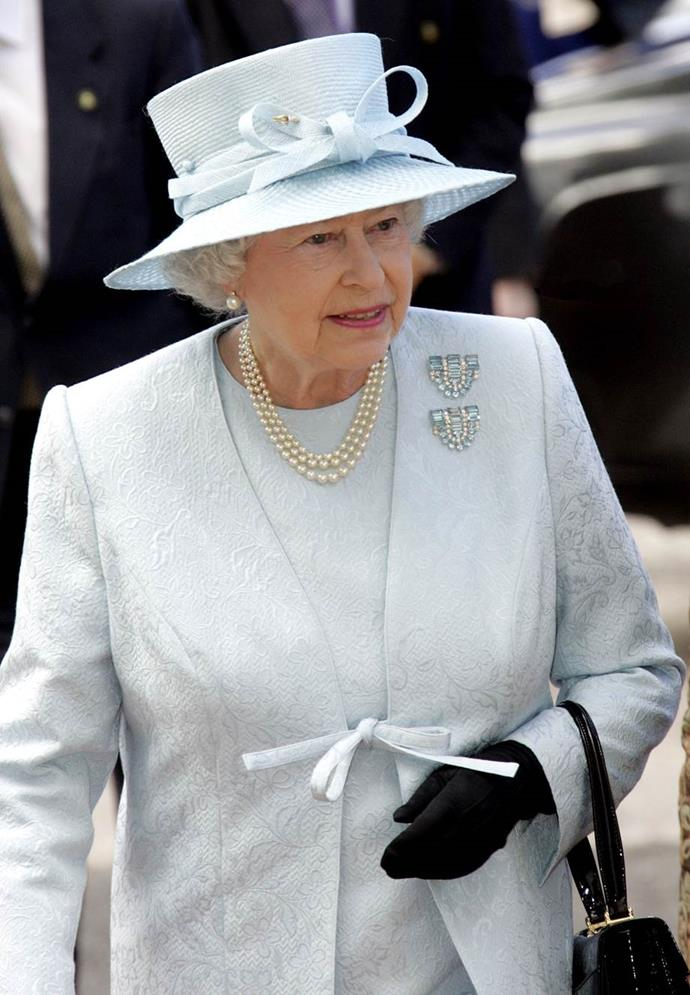 While visiting Malta the Eden Foundation On Zetjun with the Duke Of Edinburgh, Queen Elizabeth II wore this stunning detailed pastel matching blue coat and dress.