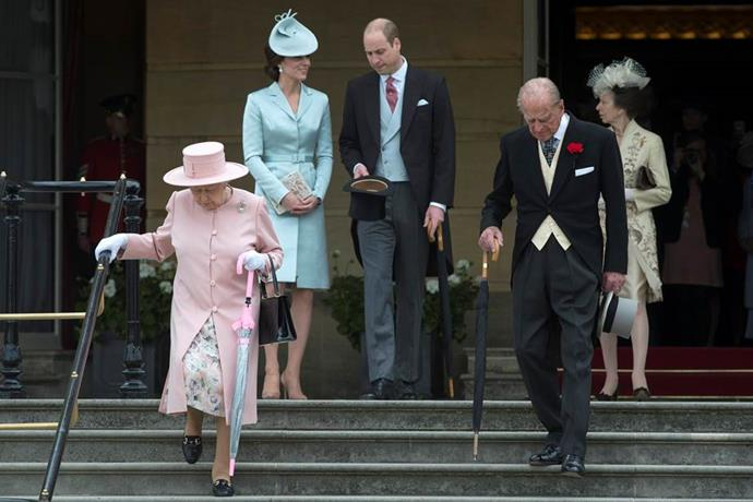 Queen Elizabeth II and Prince Phillip, Princess Anne, Duchess Catherine and Prince William arrive at a garden party at Buckingham Palace in May 2017. Kate reached way back in her closet for this nearly five-year old pastel blue silk-satin coat dress which she paired with a hat by Lock & Co.