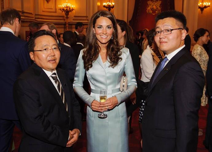 Duchess Catherine glows at a reception for State Government at the Buckingham Palace 6 years ago. Wearing a pastel blue silk-satin dress, can she be any more gorgeous?  A coat dress garment from Christopher Kane