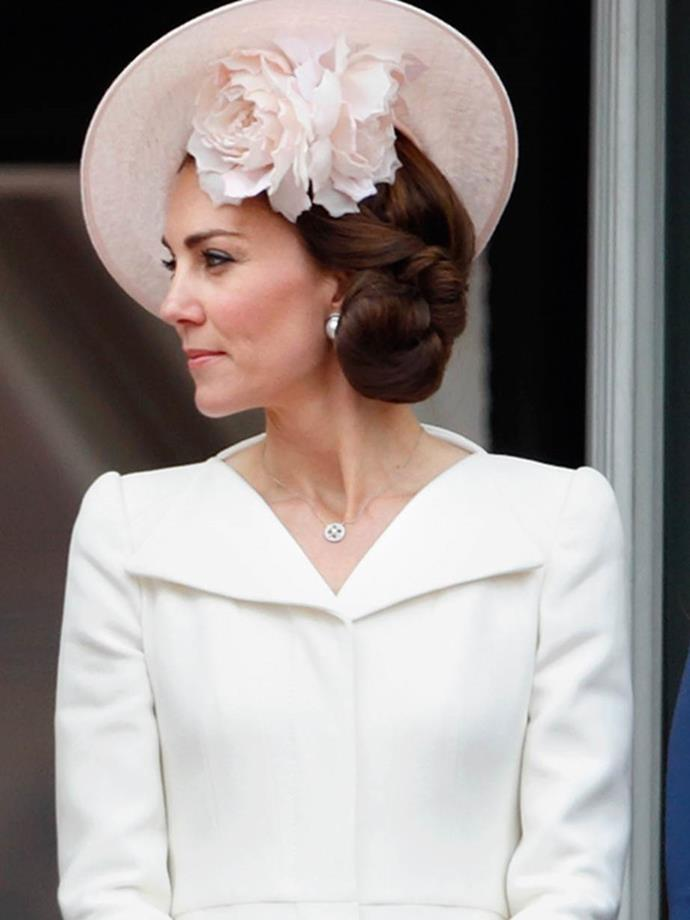 "Same dress, different hat. [The Duchess of Cambridge](https://www.nowtolove.co.nz/celebrity/royals/kates-tribute-to-diana-on-birth-of-new-baby-son-37458|target=""_blank"") stands on the balcony of Buckingham Palace during Trooping the Colour, marking the Queen's 90th birthday on June 11, 2016."