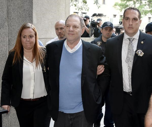 Harvey Weinstein has been arrested and charged with allegedly raping a woman and forcing another to perform oral sex.