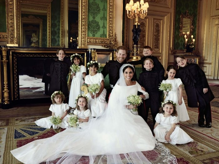 Royal wedding photographer admits he had to bribe Prince George to smile