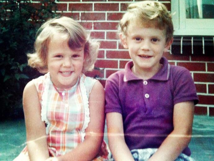 "**Hilary Barry.** No prizes for guessing this one - Hilary has barely changed. She shared this adorable photo on National Siblings Day.  ""Happy Siblings Day to my gorgeous big bro,"" she wrote. ""Rocking the cool threads since 1973."""