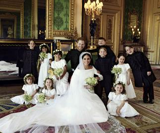 Royal wedding photographer admits he had to bribe Prince George to smile
