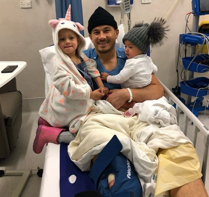 Sonny Bill recovers in hospital with his daughters Imaan, 3, and Aisha, 1.