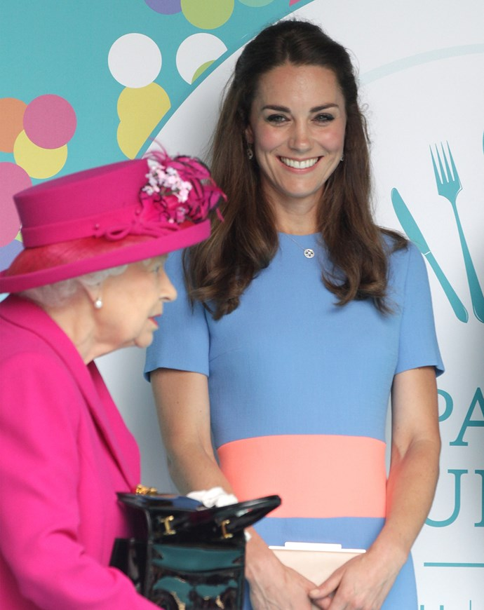 Kate looks pretty excited to be in Queen Elizabeth's company!