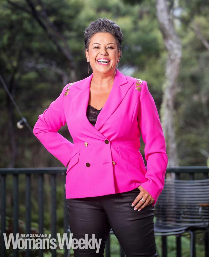 Last year, Paula would have bought a size 22 jacket – this year, she's wearing a size 14 hot-pink number and a huge smile!