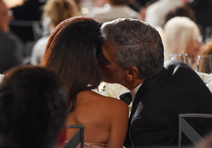 George and Amal share a tender moment during the ceremony.